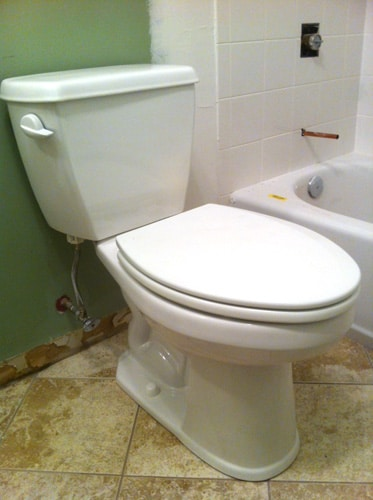 new toilet installed in bathroom
