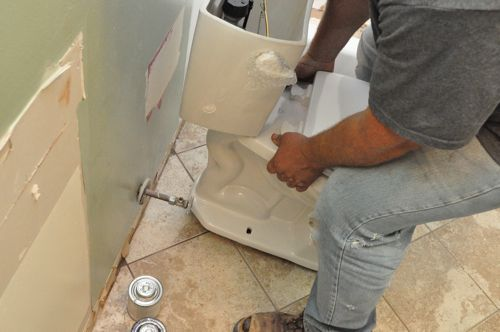 how to install a new toilet setting toilet onto closet bolts and wax ring