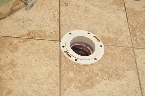 how to install a new toilet preparing flange in floor