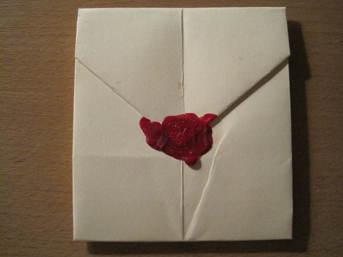 folded letter with red wax seal
