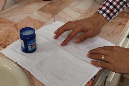 Applying essential oil to dry Towel.
