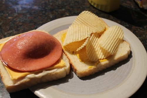 bologna sandwich fried with cheese potato chips
