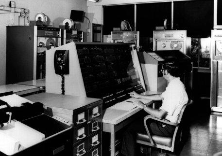 vintage man working at large computer