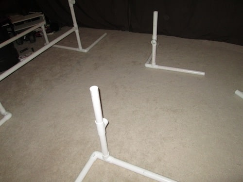 Step 11: Insert one 1 foot PVC pipe into the top of the T sections.