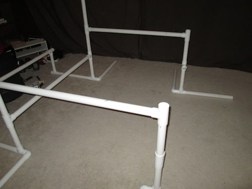 Step 12: Insert a T section on top of the one foot PVC pipe and make sure the middle hole is facing inward. Then insert a 4 foot PVC pipe into the middle hole as a cross beam for your gym. Do this on both sides.