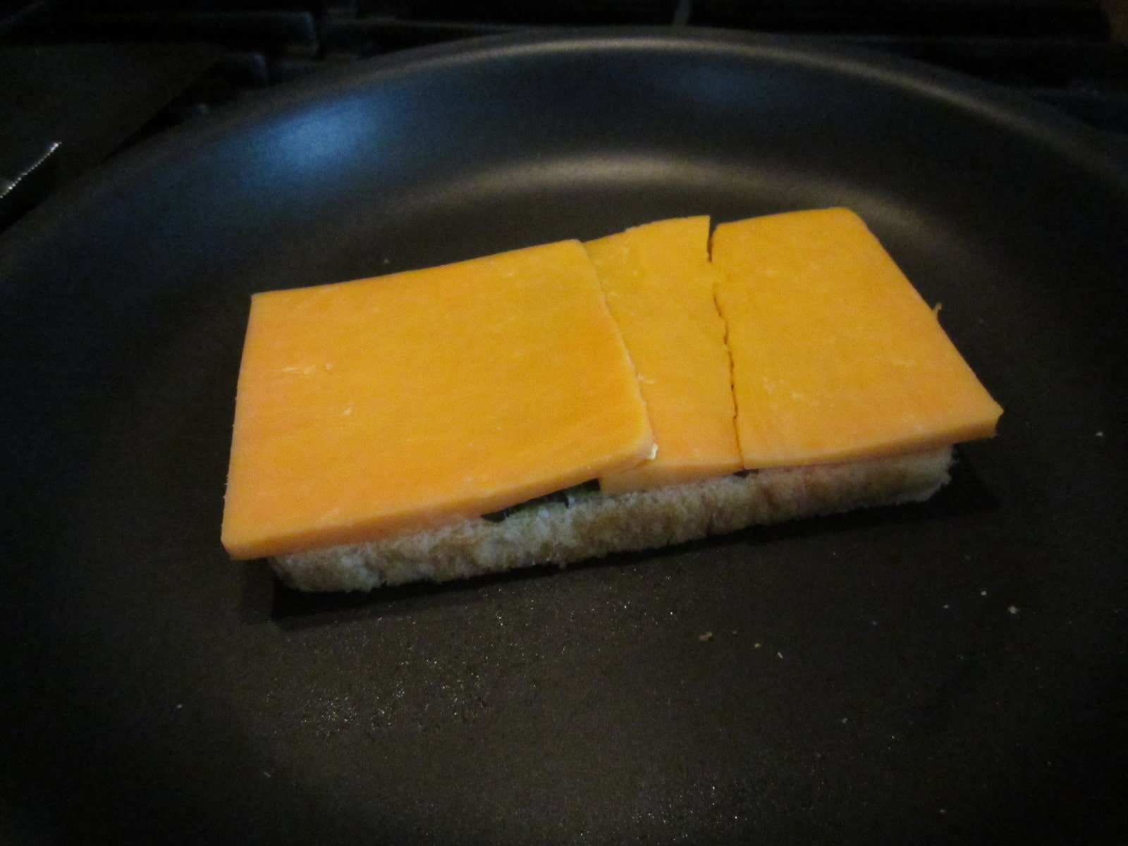 A couple good, hearty slices of sharp cheddar.