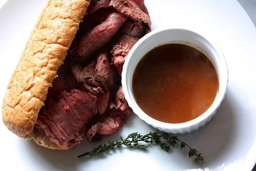 Vintage homemade roast beef au jus illustration.