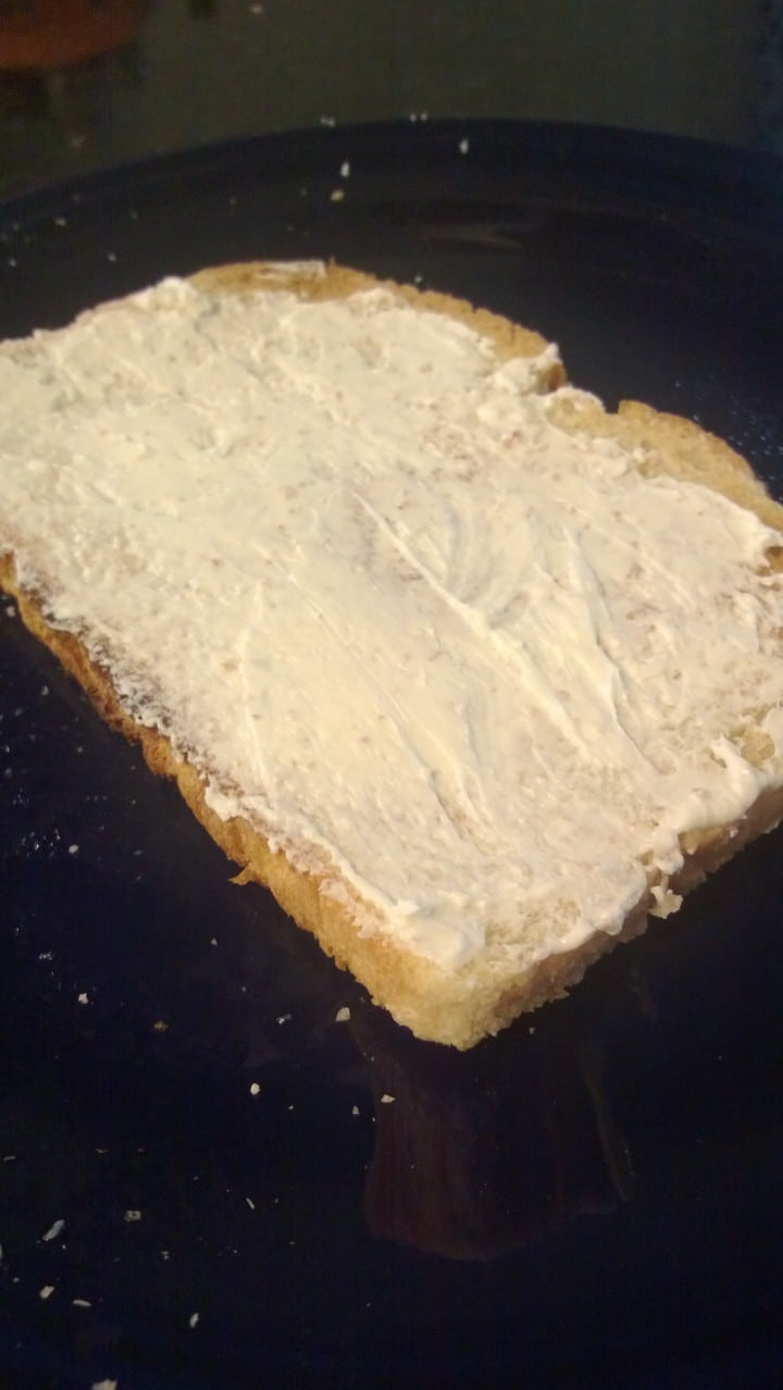 I gave it a good slathering. I've learned from experience not go do a light spread when it comes to cream cheese on sandwiches.