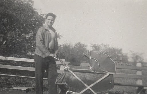 vintage man walking baby in stroller