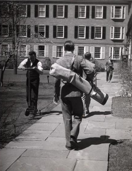 Vintage students walking on campus with books supplies.