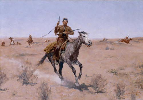Cowboy painting man riding horse in desert with gun.