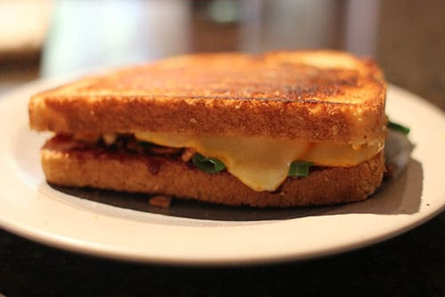 Grilled cheese sandwich with green onion raspberry jam.