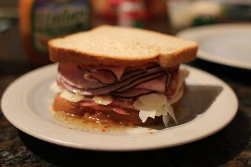 Italian cold cut sandwich with cheese and oil.