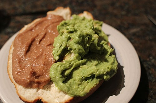 Vintage bread and guac, mashed beans in a plate.