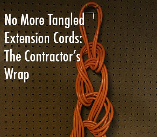 wrapped extension cord hanging from peg board