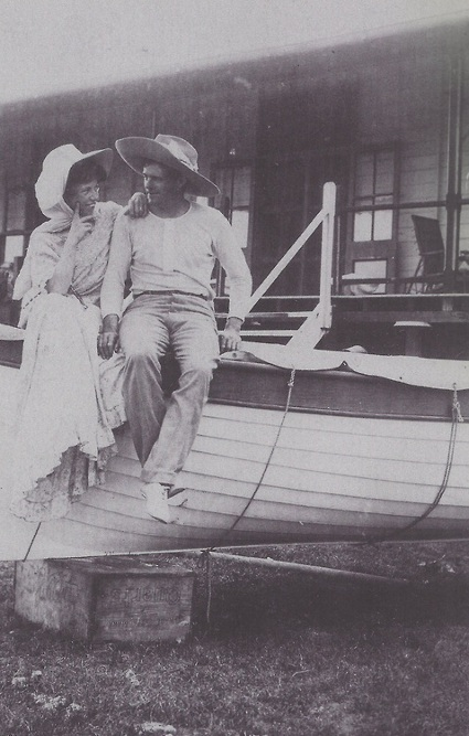 Jack London and charmian sitting on yacht.