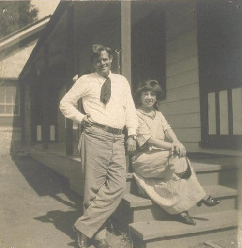 Jack London and wife mate-woman charmian on front porch.