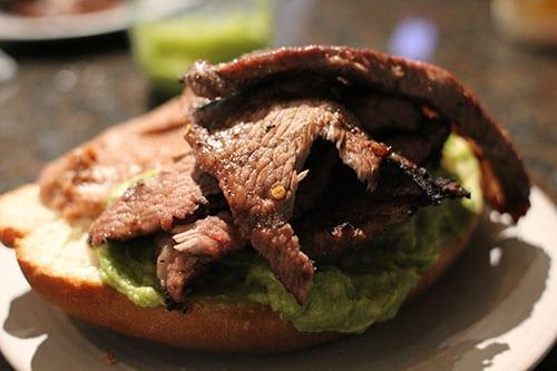 Carne asada torta sandwich guacamole.
