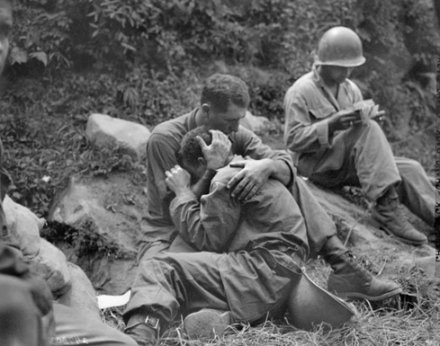 vintage soldier crying being consoled hugged by another soldier