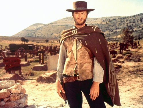 good bad ugly clint eastwood standing with blanket around shoulders