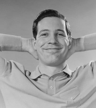 vintage man in polo shirt smiling hands behind head