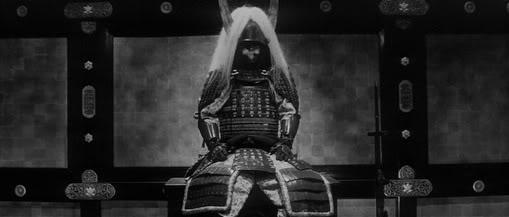 vintage samurai in war gear preparing in private room