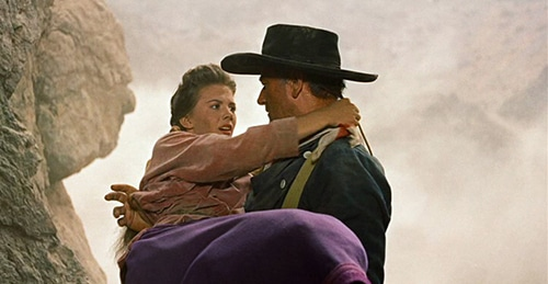 Searchers old western movie film john wayne carrying woman.
