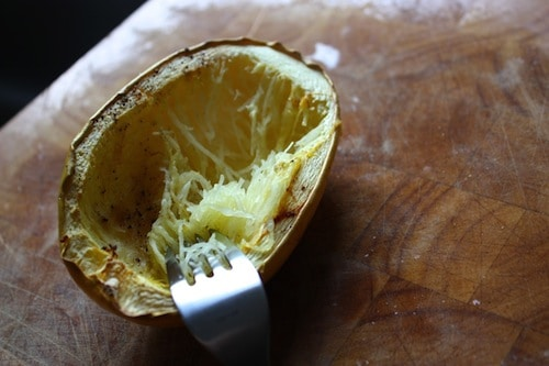 spaghetti squash cutting with fork into thin strands