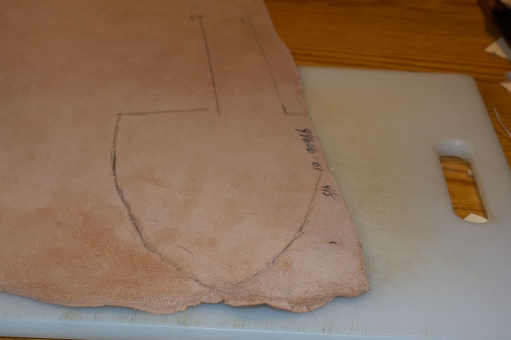 Vintage tracing and cutting piece of leather.