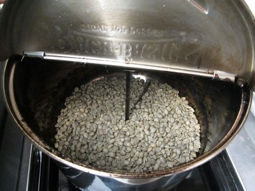 roasting green coffee beans in popcorn popper on grill