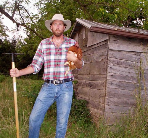 Forrest pritchard farmer with chicken in arms.
