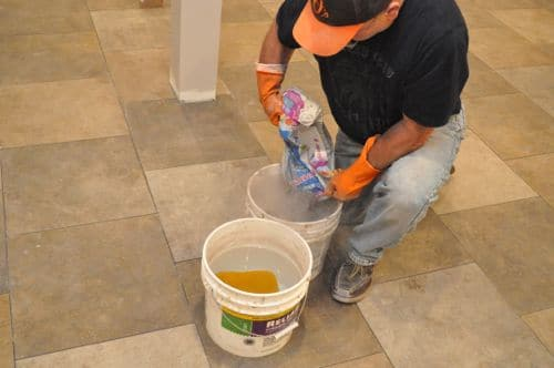 mixing grout in buckets