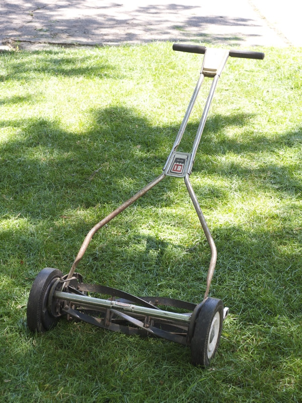 craftsman reel mower on green lawn grass