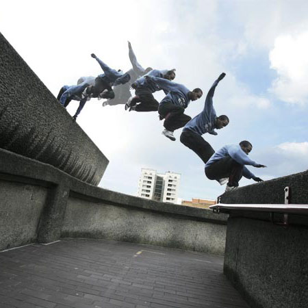 Parkour stop motion photo multiple steps of jump from walls.