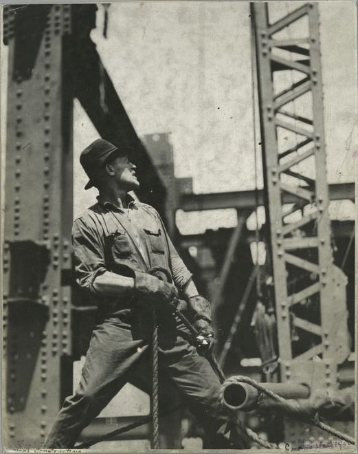 vintage blue collar steel worker on construction site