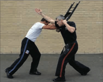 Krav Maga Technique of the Month: Defending a Two-Handed Overhead Chair or Stool-Type Attack | The Art of Manliness