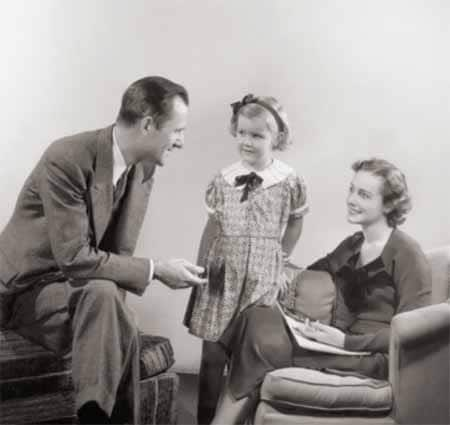 vintage family dad talking to wife and daughter