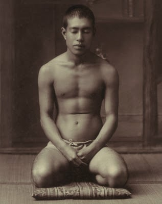 vintage young man meditating kneeling