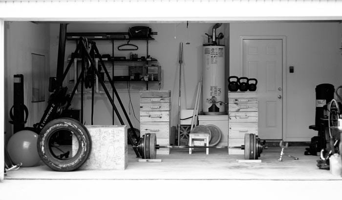 Garage gym DIY workout room at home PLYO box tire weight rack.