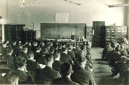 Vintage high school college classroom students listening to lecture.