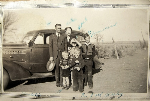 Vintage family with 4 kids standing in front of car 1920s 1930s.