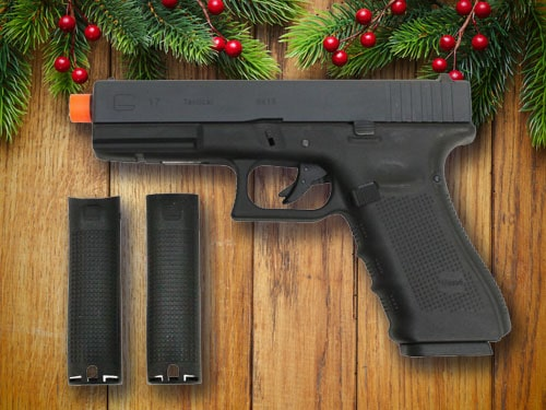 Airsoft gun with christmas background.