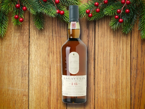 Bottle of scotch with christmas background.