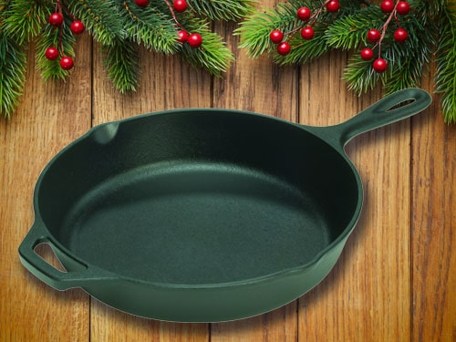 Cast iron skillet with christmas background.