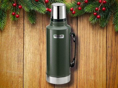 Stanley thermos with christmas background.