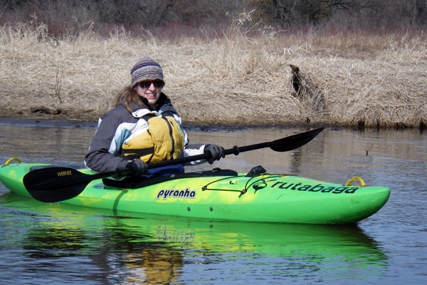 Brenna paddles a crossover whitewater kayak