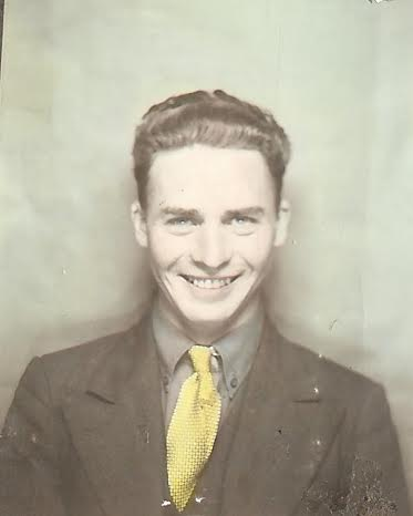 bob lynes vintage young man portrait chest up suit and tie big smile