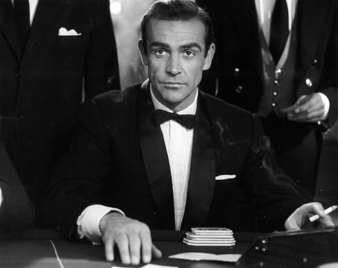 James bond sean connery wearing tuxedo gambling.