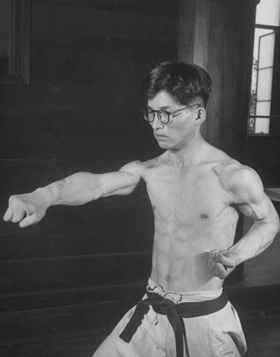 vintage man man practicing martial arts karate punch