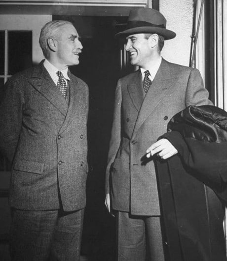 Vintage businessmen in suits meeting talking smiling.